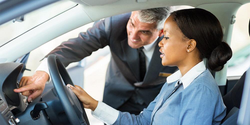 Woman looking at a new car
