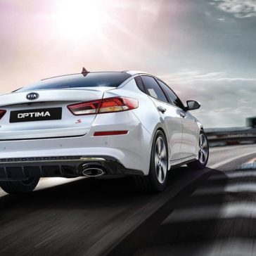 2019 Kia Optima rear driving in white