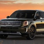 Kia Telluride Driving By Sunset copy