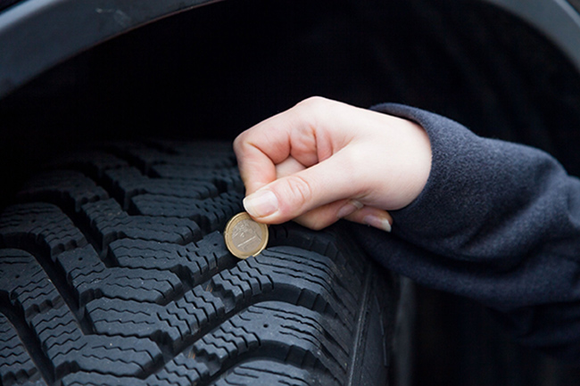 checking tire tread depth with a penny